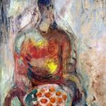 Gyümölcskosarat tartó nő